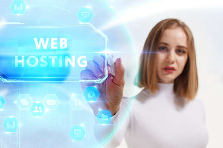 Business, Technology, Internet and network concept. Young businesswoman working on a virtual screen of the future and sees the inscription: Web hosting