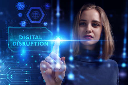 Business, Technology, Internet and network concept. Young businesswoman working on a virtual screen of the future and sees the inscription: Digital disruption 스톡 콘텐츠