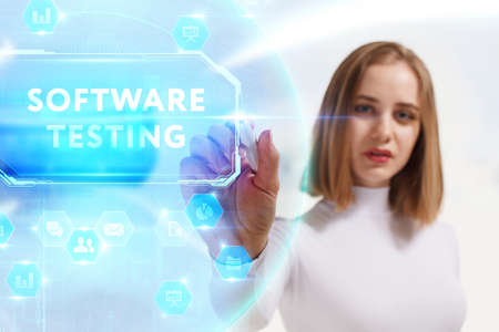 Business, Technology, Internet and network concept. Young businesswoman working on a virtual screen of the future and sees the inscription: Software testing 스톡 콘텐츠