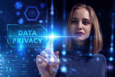 Business, Technology, Internet and network concept. Young businesswoman working on a virtual screen of the future and sees the inscription: Data privacy 스톡 콘텐츠