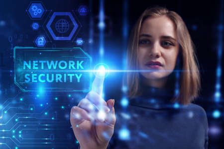 Business, Technology, Internet and network concept. Young businesswoman working on a virtual screen of the future and sees the inscription: Network security 스톡 콘텐츠
