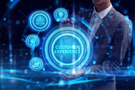 Business, Technology, Internet and network concept. Young businessman working on a virtual screen of the future and sees the inscription: Customer experience
