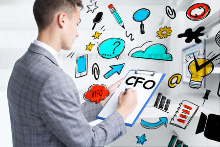 Business, technology, internet and network concept. Young businessman thinks over the steps for successful growth: CFO