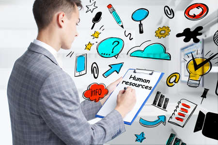 Business, technology, internet and network concept. Young businessman thinks over the steps for successful growth: Human resources