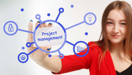 Business, Technology, Internet and network concept. Young businessman working on a virtual screen of the future and sees the inscription: Project management