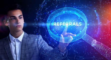 Businessman presses button referrals on virtual screens. Business, Technology, Internet and network concept. Foto de archivo