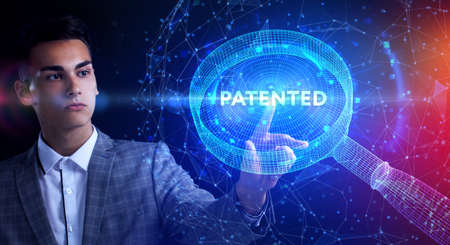 Business, Technology, Internet and network concept. Young businessman working on a virtual screen of the future and sees the inscription: Patented