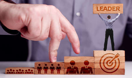 Successful team leader. Business leadership concepts. A successful team leader is a manager market leader