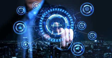 Cyber security data protection business technology privacy concept. Young businessman select the icon Data security on the virtual display. Reklamní fotografie