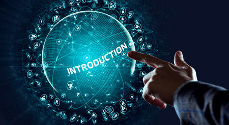 Business, Technology, Internet and network concept. Young businessman working on a virtual screen of the future and sees the inscription: Introduction Фото со стока