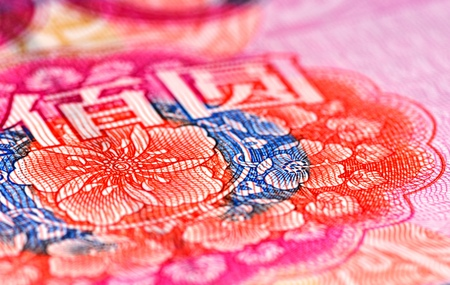 geldschein: Enlarged view of an portion of the 100 RMB note showing colorful flowers and two Chinese characters (BAI and YUAN) Stock Photo
