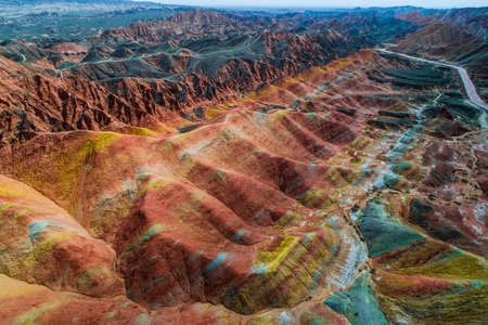Aerial view on the colorful rainbow mountains with amazing pattern in Zhangye danxia landform geological park in Gansu province, China.
