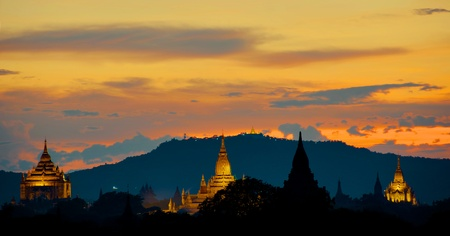 Sunset over Bagan with illuminated Pagodas and golden sky Stok Fotoğraf