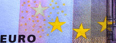 fifty euro banknote: Macro photograph of the observe of a fifty euro bill showing yellow stars and the word euro
