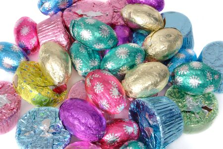 Easter chocolate in foil over white Imagens