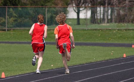 Two students race in a track meet Stock Photo