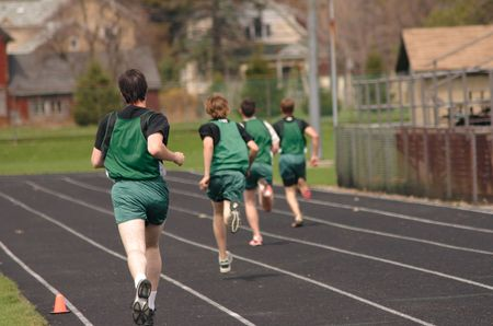 Boys race at a track meet