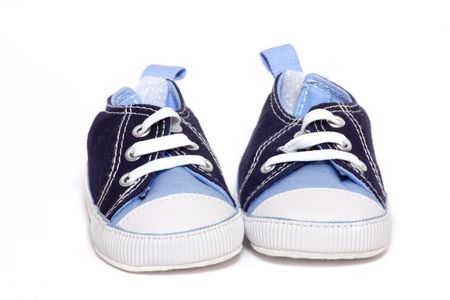 Pair of  sneakers over white