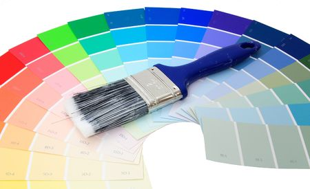 Colorful paint samples over white with paint brush Stok Fotoğraf