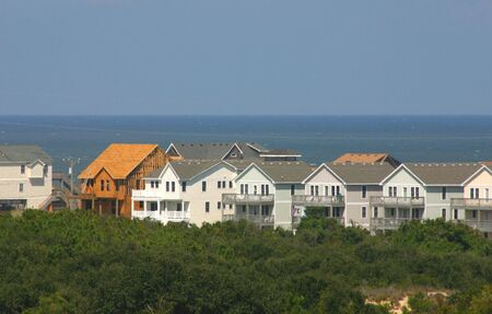 despite: New beach homes being constructed on the beach, despite many hurricanes Stock Photo