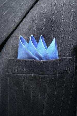 breast pocket: Blue handkerchief inside a pinstripped suit breast pocket