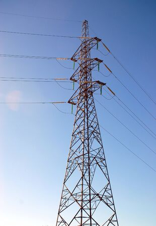 Electricity pylon stands out from a blue sky Stock Photo
