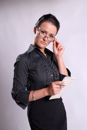 Young business woman with pad and pen