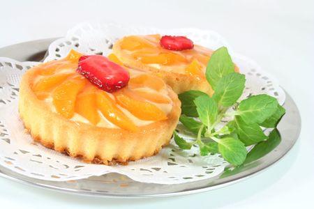 confiserie: Apricot tart with lemon balm on a silver platter