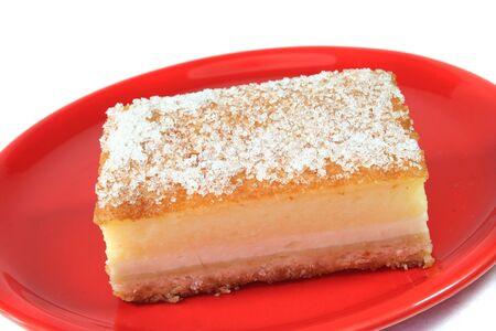 speciality: custard-topped cheesecake-style speciality on a red plate
