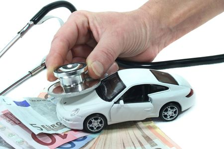 Stethoscope with car and euro notes on a white background