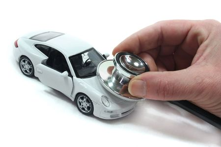 Stethoscope with car on a white background photo