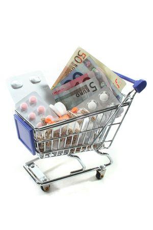 billets euros: Votre panier avec tablettes et des billets en euro Banque d'images