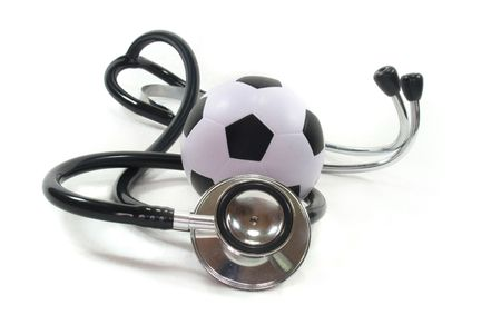 Stethoscope with football on a white background photo