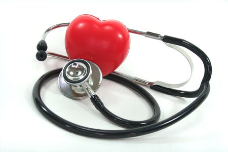 lovesickness: Stethoscope with red heart on a white background
