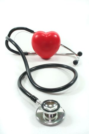 palpitations: Stethoscope with red heart on a white background