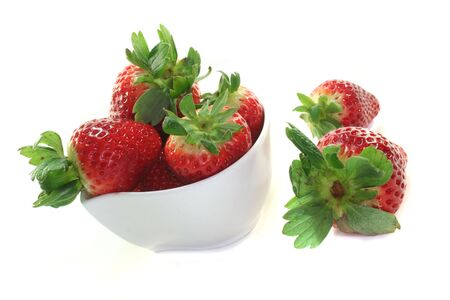 jams: Strawberries in a bowl on a white background Stock Photo