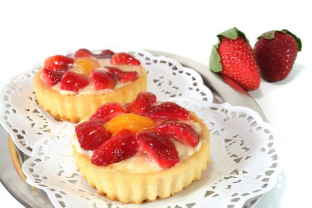 confiserie: Strawberry tarts with mint on a silver platter Stock Photo