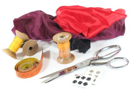 presumptuous: old bobbin with needle, measuring tape, Scissors and Silk on a white background