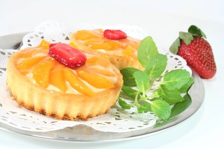 confiserie: Apricot tart with lemon balm on a silver platter