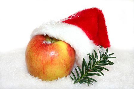 Apple with Santa Hat in snow Stockfoto
