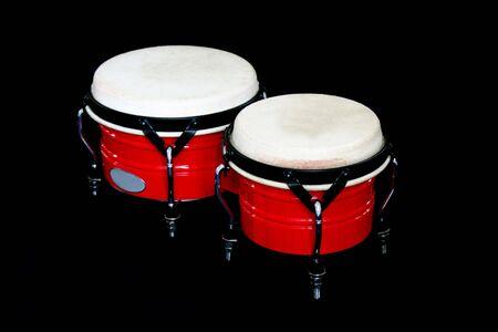 bongos: red Bongos on a black background Stock Photo
