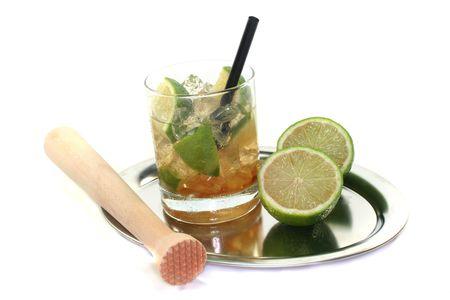 Caipirinha on a tray with fresh lime