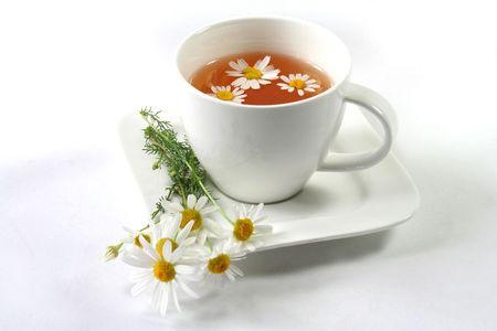 Chamomile tea with chamomile flowers Stockfoto