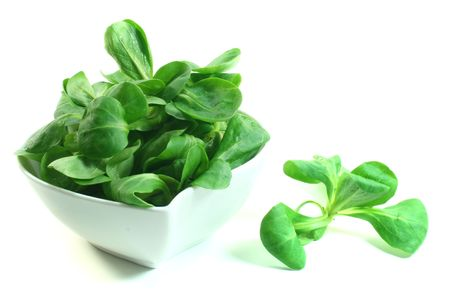 rapunzel: Lambs lettuce in a bowl on a white background Stock Photo