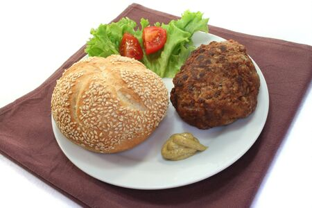 Meatball with sandwiches and salad on brown napkin photo