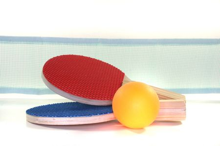 two Table tennis racket and ball on a white background
