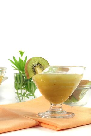 woodruff: Green jelly with kiwi fruit, rhubarb and sweet woodruff Stock Photo