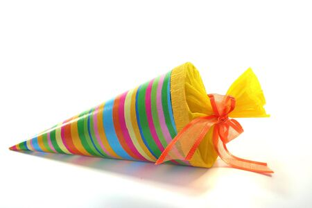 a colorful school cone filled with candy on a white background