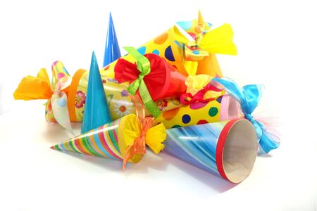 many colorful school cones filled with candy on a white background Stock fotó