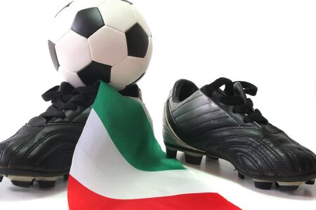 soccer wm: flag of Italy with soccer shoes and football Stock Photo